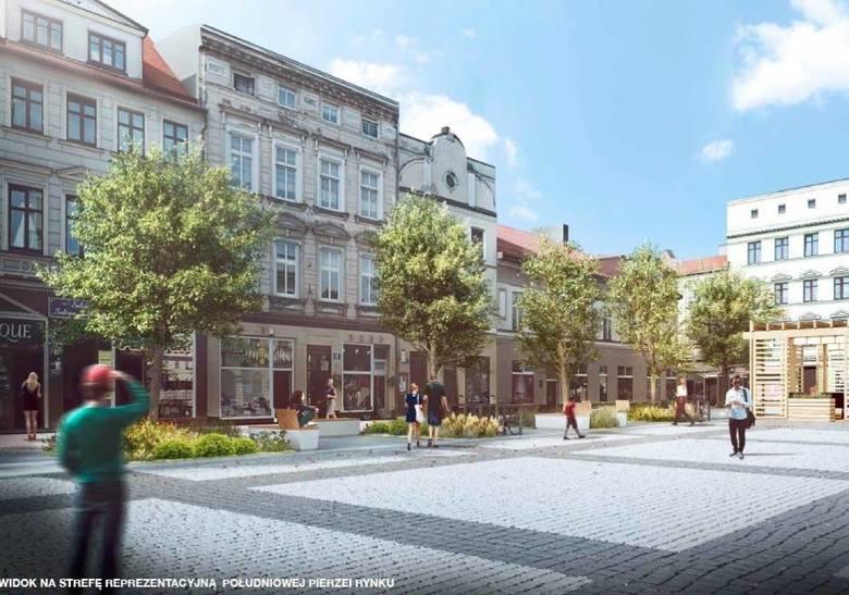 Plac na Rynku przed Ratuszem. Meble miejskie wśród zieleni niskiej oraz drzew.